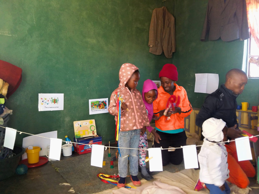 Mmapule Mothobi with two of the children in her Ratlou playgroup.