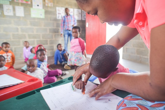 Practitioner and child in early learning centre in KwaZulu-Natal